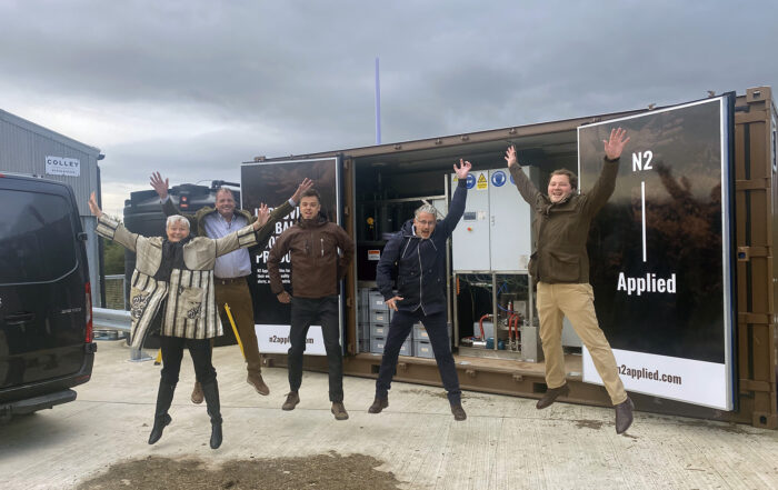 N2 Applied colleagues jumping in celebration at Spen Farm